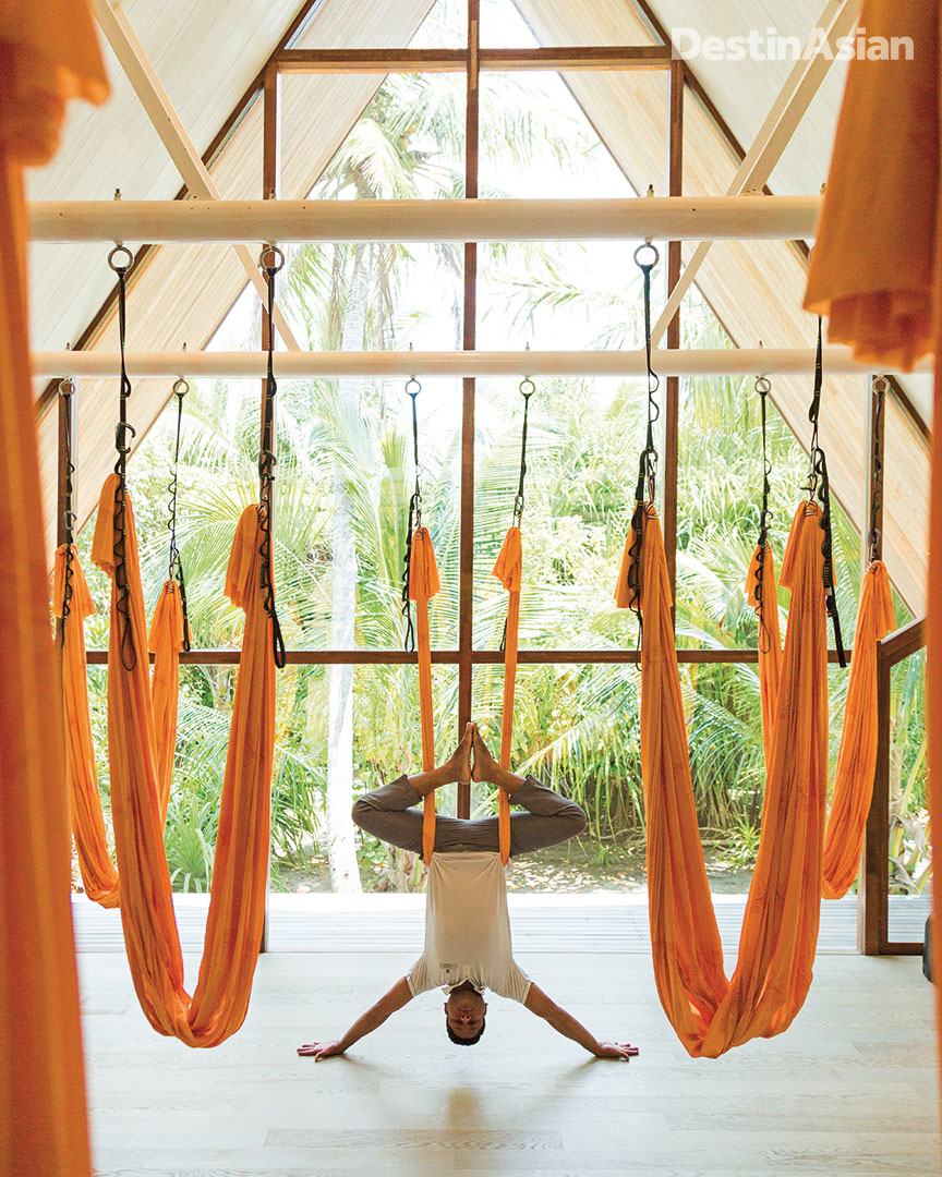 The St. REgis Maldives Commuli's in-house yoga master Muhammed Faisal demonstrating anti-gravity yoga.