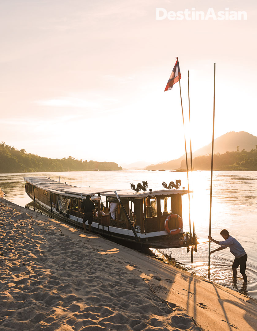 The Dok Keow moored at a sandbank in the Mekong River for sunset views.