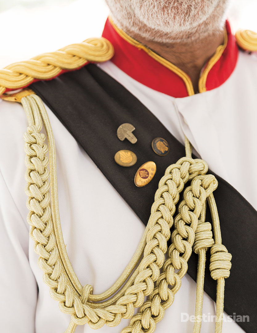 A detail of the Raffles' doorman's Savile Row-designed military uniform.