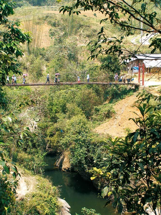 A vertigo-inducing footbridge near Cat Cat village.