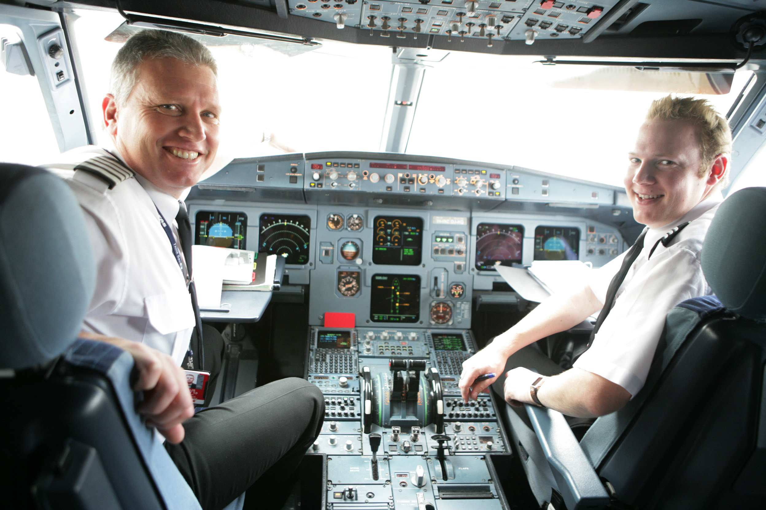 Two Jetstar pilots in an A320 aircraft.