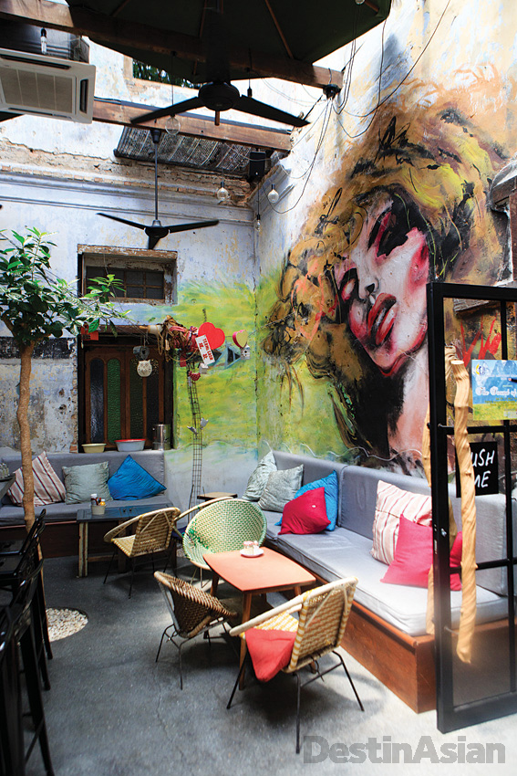 The alfresco bar at Burps & Giggles features wall art by local talents.