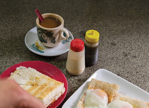 A breakfast of white coffee with kaya toast and soft-boiled eggs at Sin Yoon Loong.