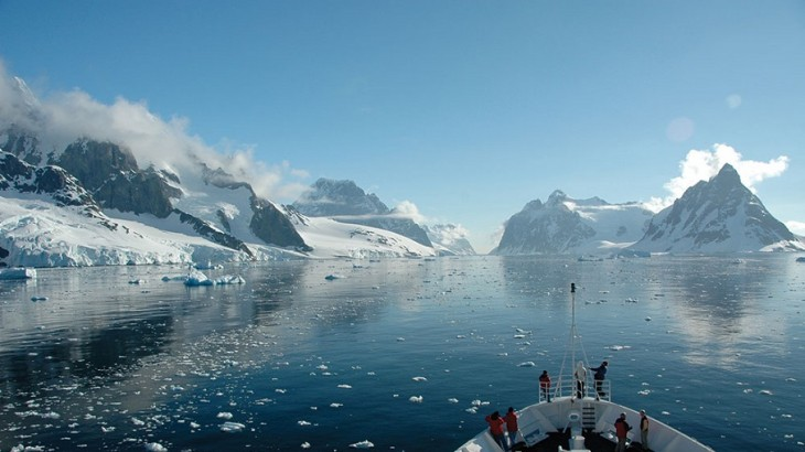 Passengers aboard Le Boréal take in the wild beauty of the Antarctic Peninsula's Lemaire Channel.