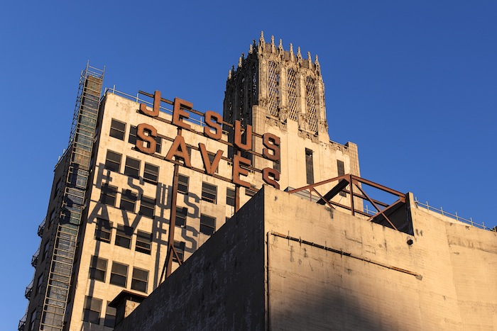 The cheeky exterior signage of the Ace Hotel Downtown L.A. remain from an evangelical minister who once occupied the building.