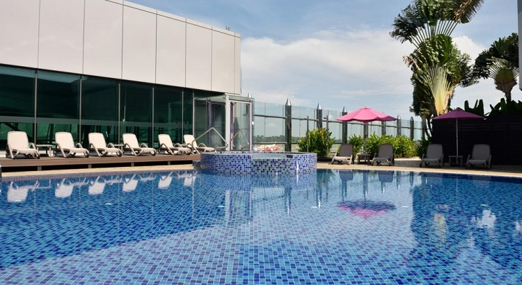 The hotel features an outdoor pool with a pool-side bar.