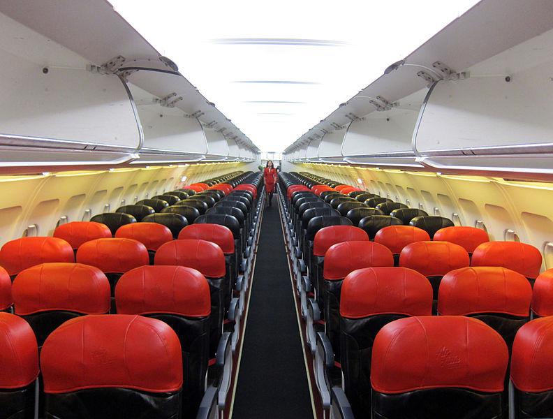 The interior of AirAsia's signature red cabin.