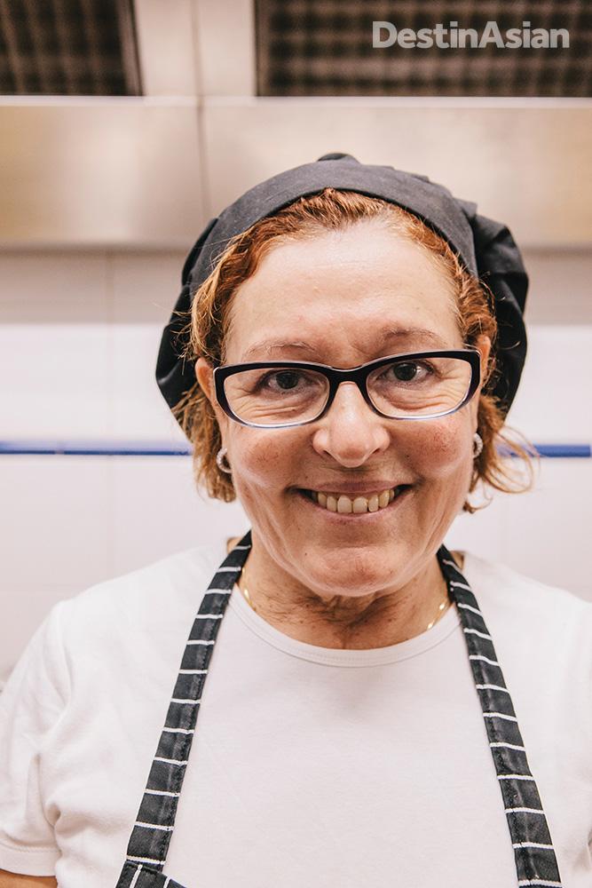 Carolina Oliveria in the kitchen of Tasquina do Oliveira.