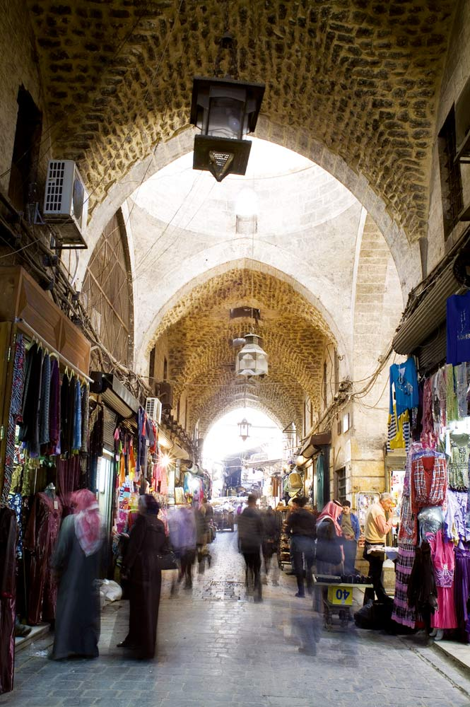 Amid the bustling archways of Aleppo's legendary souk; terrace seating at Sissi House.