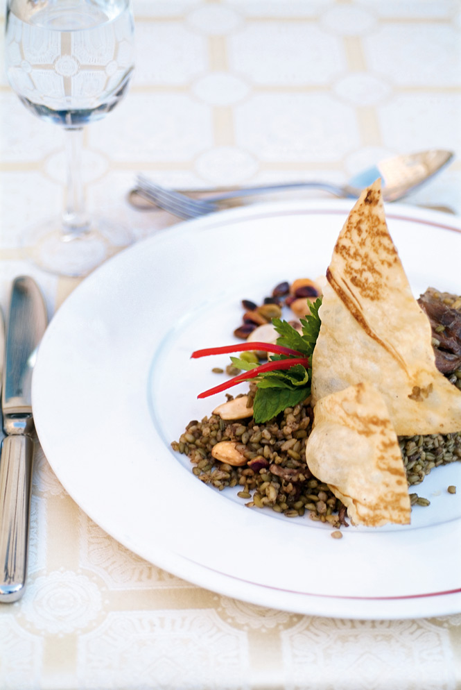 Yogurt-cooked lamb (sharod) with  bulgur and crispy lavash bread, at the Sheraton Aleppo Hotel's Al Mawal restaurant.