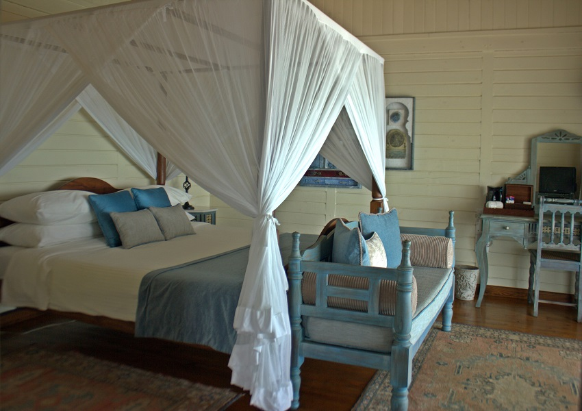 The beachy interior of one of the pool villas.