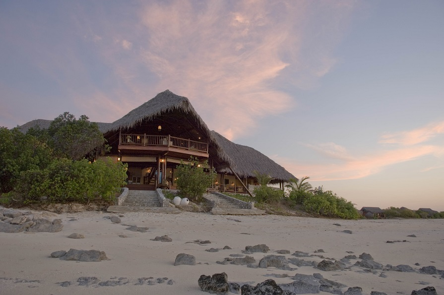 The main building, nestled up to the beach at sunset.