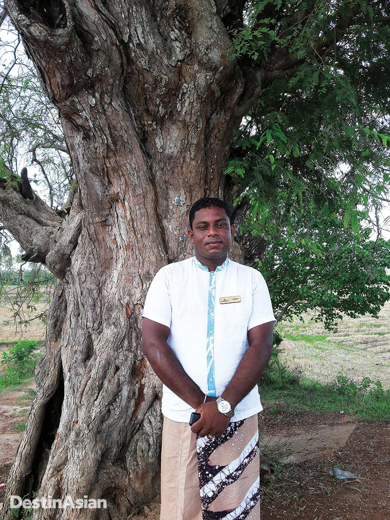 Villa host and experience guru Kanishka Sandaruwan posing in the Tangalle countryside.