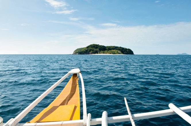 Approaching Mangenguey Island by outrigger.