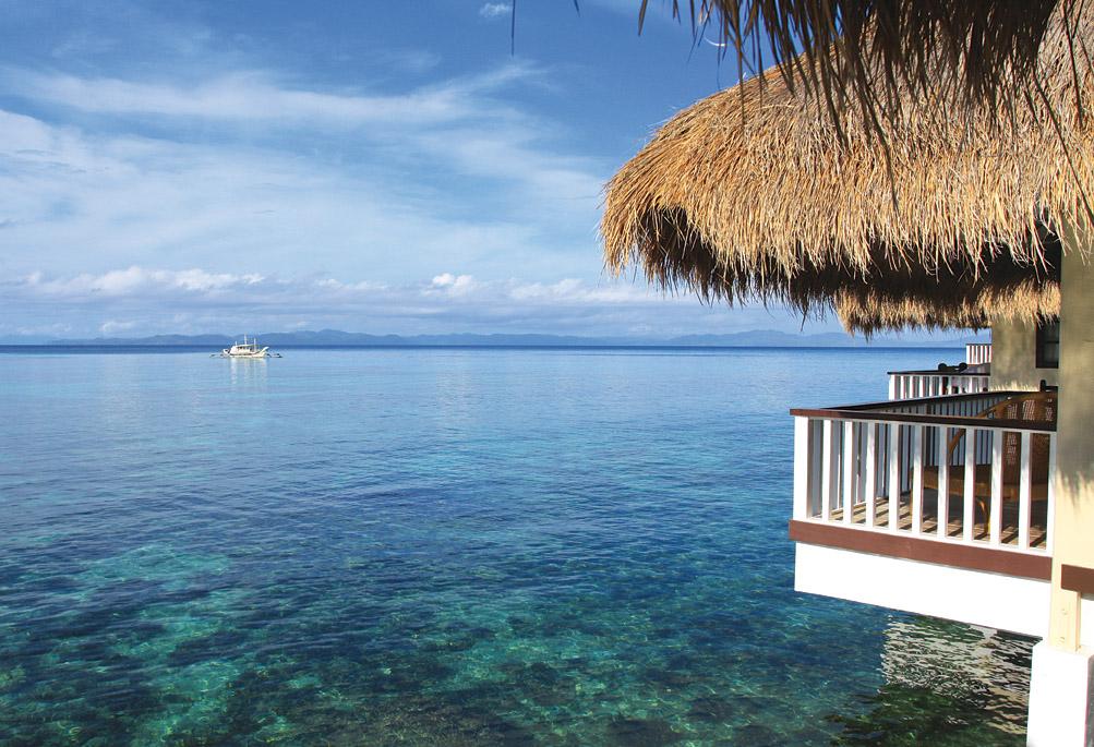 Waterside cottages at Apulit Island Resort.