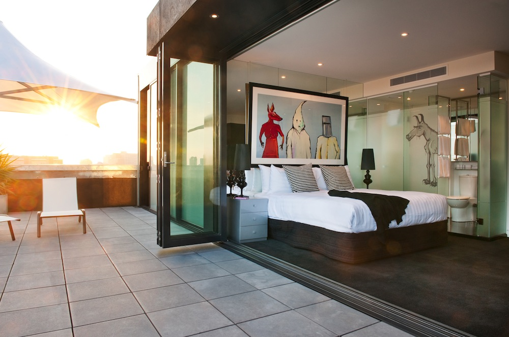 An airy bedroom at The Cullen, an Art Series hotel.