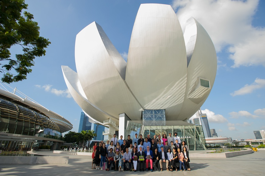 The artists in front of ArtScience Museum's blossoming architecture.