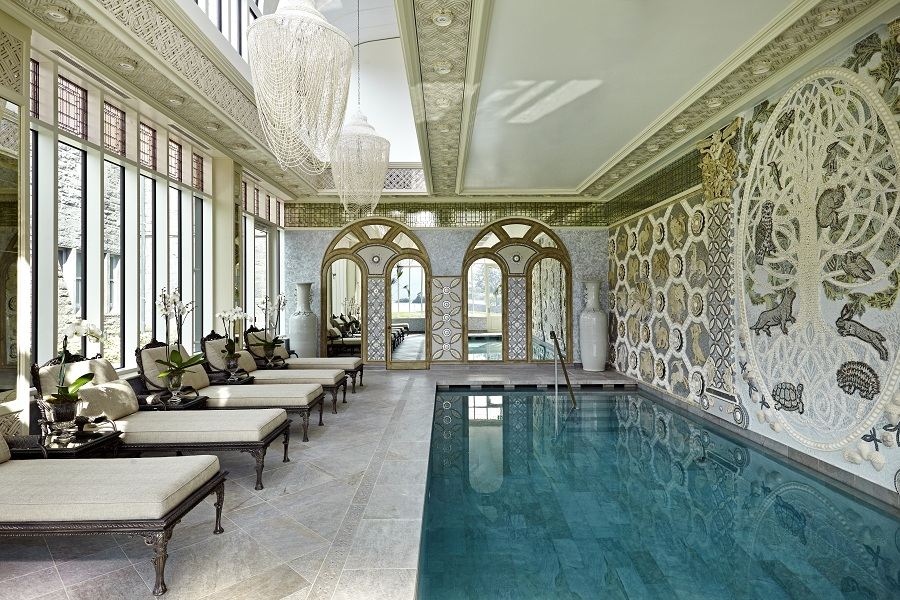 The indoor pool backed by a mozaic mural by South African artist Jane du Rand.