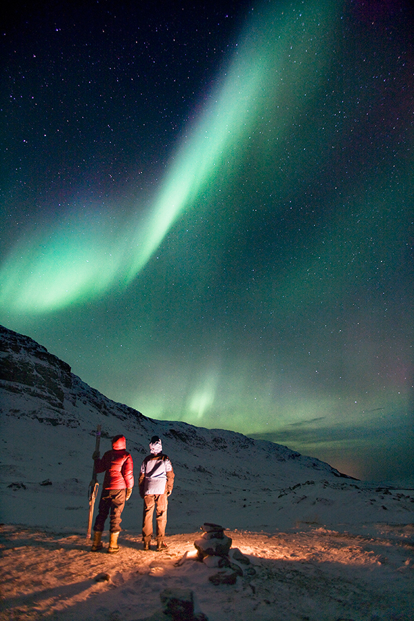 Admiring the aurora borealis from a vantage point in front of northern Sweden's Aurora Sky Station, perched 900 meters above sea level.