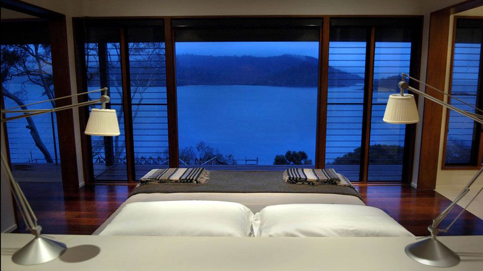 A bedroom ocean view at Qualia.