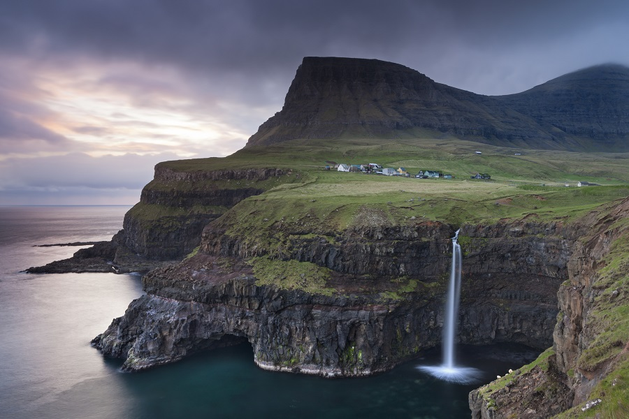 Dramatic coastal scenery at Gasadalur on the island of Vagar, Faroe Islands. (Photo credit: Adam Burton)