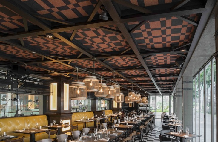 Wilson Associates' Blueplate Studios designed the two-story restaurant to reflect that of the East London flagship.