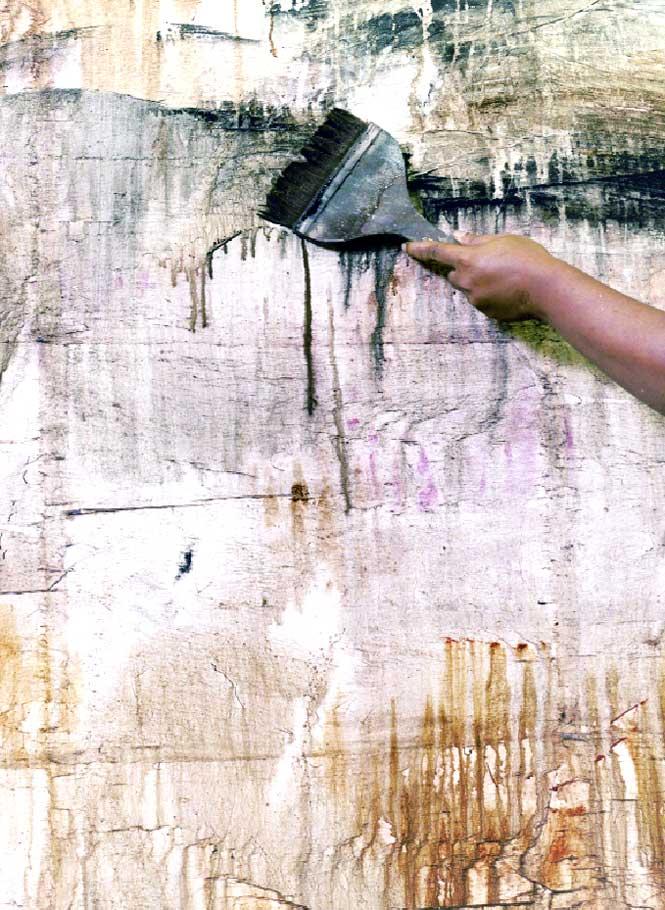 Balinese painter Putu Sutawijaya at work.