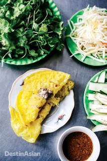 A banh xeo shrimp pancake filled with pork, bean sprouts, and fresh herbs served here at Banh Xeo Ba Duong.