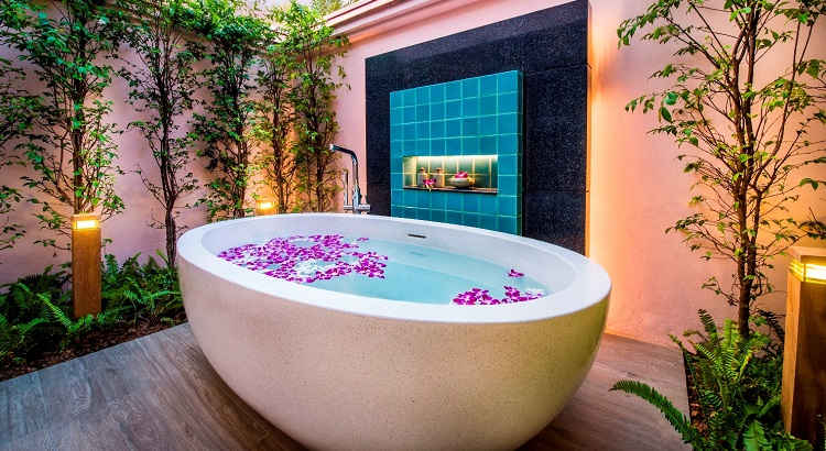 An outdoor bath tub at one of the villas is the perfect space to relax and refresh.