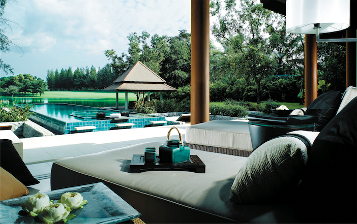 A lounger facing the pool and sala.
