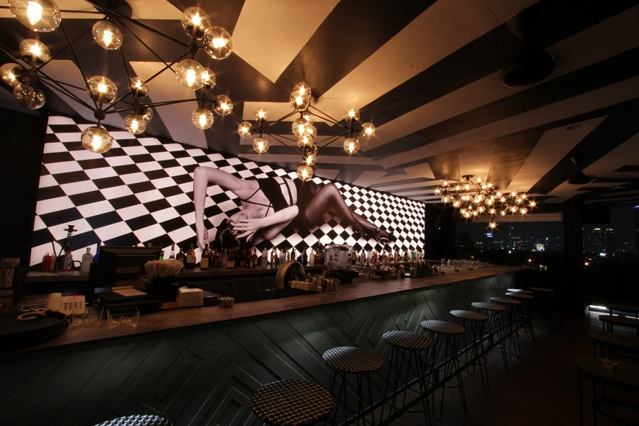 Art lighting and a photography mural decorate the bar area.