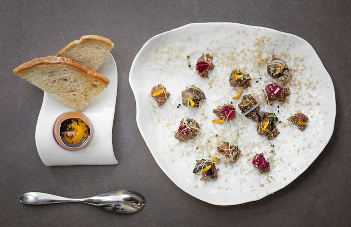 Beef tartare served with confit egg yolk and toast by Chef Walsh.