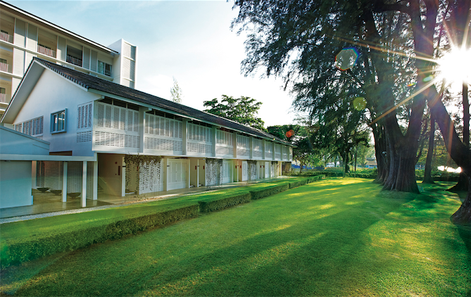 The heritage wing, the beachfront lawn, and a glimpse of the casuarinas.