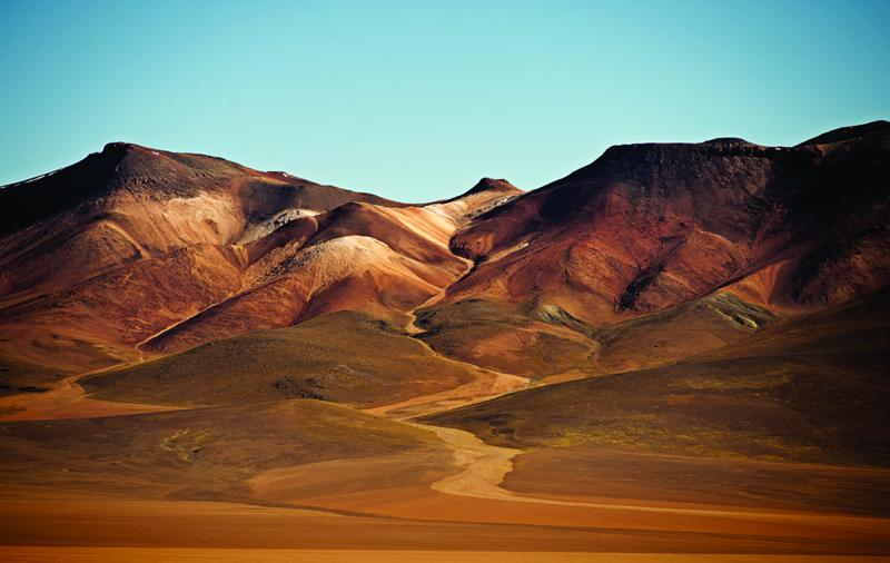 The Salvador Dali desert - a wilderness where raw minerals - zinc, copper, silver - infuse the landscape, painting a vivid, surrealist canvas of perplexing scale in which geological time is the only real measure.