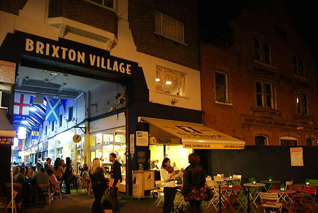 The entrance to Brixton Village by night.