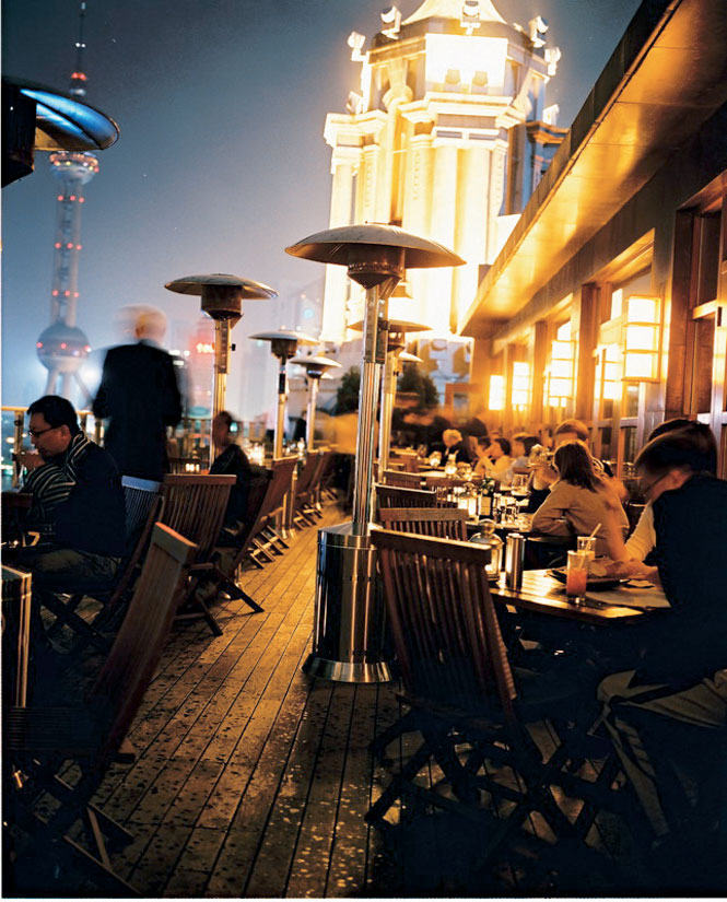 Alfresco dining on the terrace at New Heights, a bar-cum-restaurant perched above Shanghai's Bund riverfront.