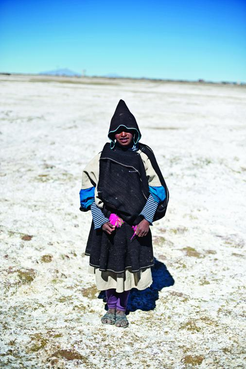 Traditionally, Chipaya women wear a white dress as an undergarment, with a dun coloured woollen poncho over the top for warmth.