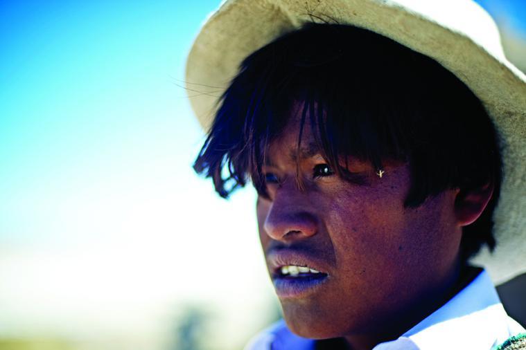 Samuel Mamani Chino gazes across the tundra as he prepares to go hunting for flamingos.