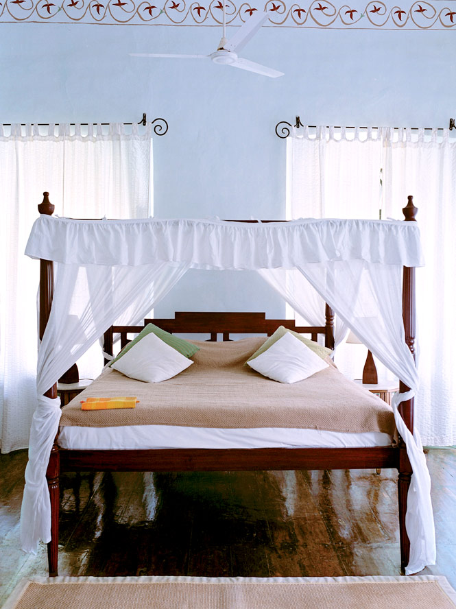 A. bedroom at Siolim House.
