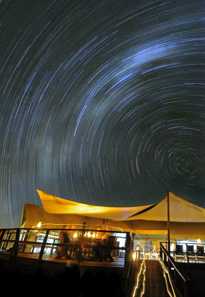 Sal Salis Ningaloo Reef camp at night. Photographed by Andy Rouse.