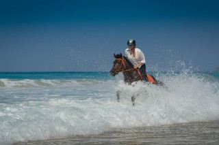 Carol Sharpe on a beach ride, one of the resort's most popular equestrian activities.