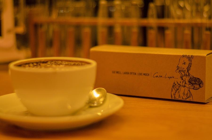 Casa Lapin's mocha and box of signature macaroons.