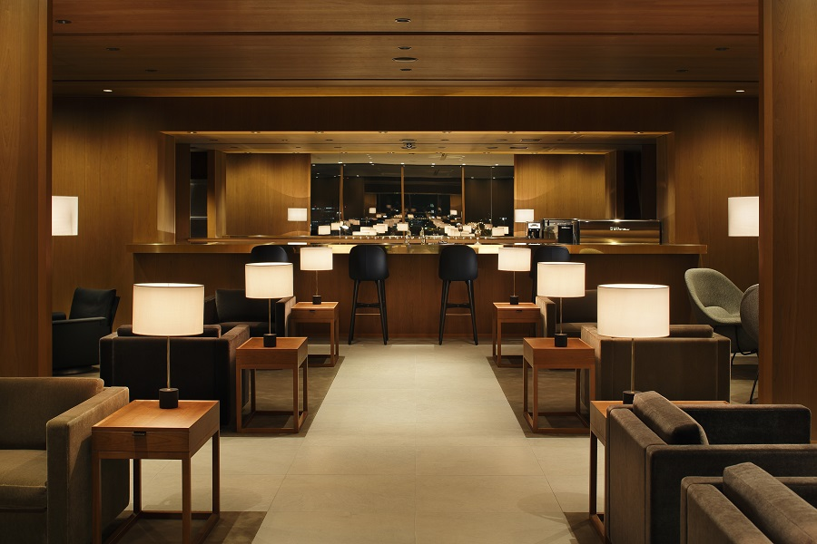 Cathay's new lounge in Haneda has warm, neutral tones and wood accents that will be emulated in the rest of its lounges.