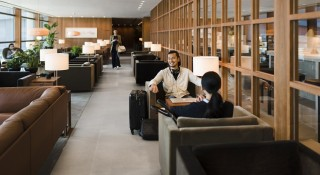 "The lounge's ""slow"" lane allows passengers to kick back and relax in between flights."