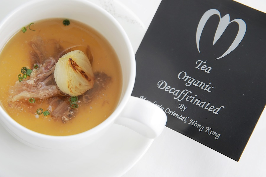 A full-bodied consommé with a specially prepared tea bag of dried flower petals and gold flakes.