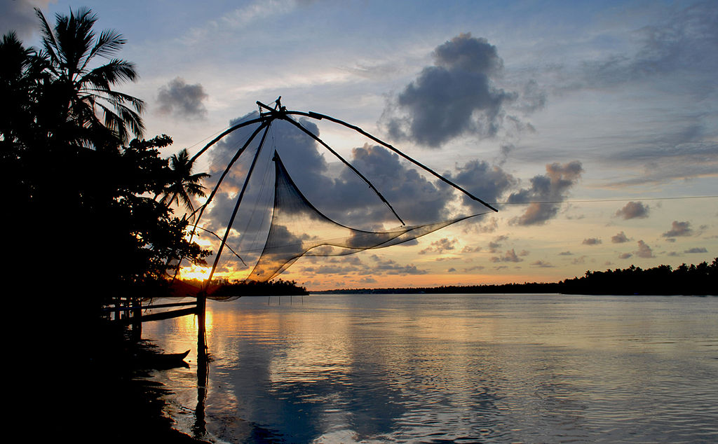 The iconic Chinese fishing nets at Fort Kochi also double also a seaside dining venue.
