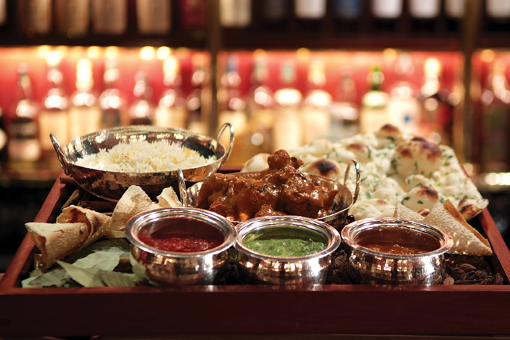 Curry and condiments at the Mandarin Oriental's venerable Chinnery lounge.