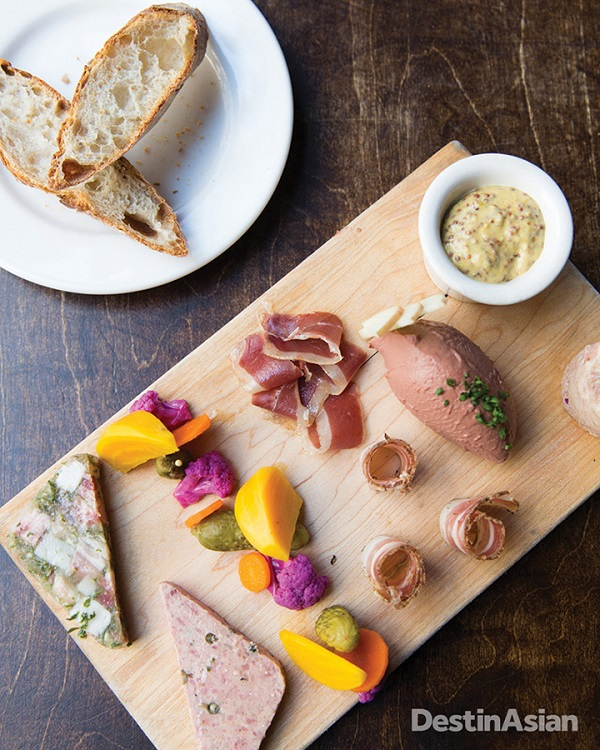 The charcuterie plate at Church and State includes duck prosciutto, country pate, and cured pork belly.