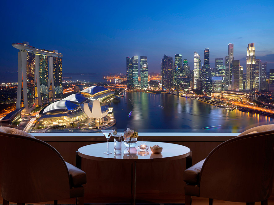 The club lounge has a stunning view of downtown Singapore.