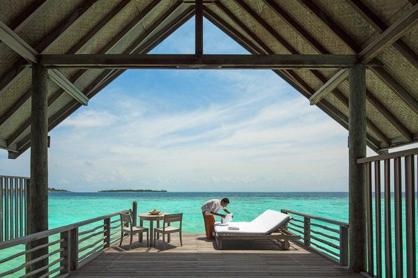 All of Cocoa Island's rooms come with private outdoor sun decks and direct access to the turquoise lagoon.